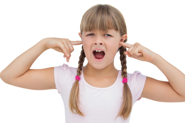 Little girl clogging her ears with her fingers